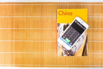 Time Warner Phone 2 Go app allows customers to tap into their home phone lines to make and receive calls while overseas.