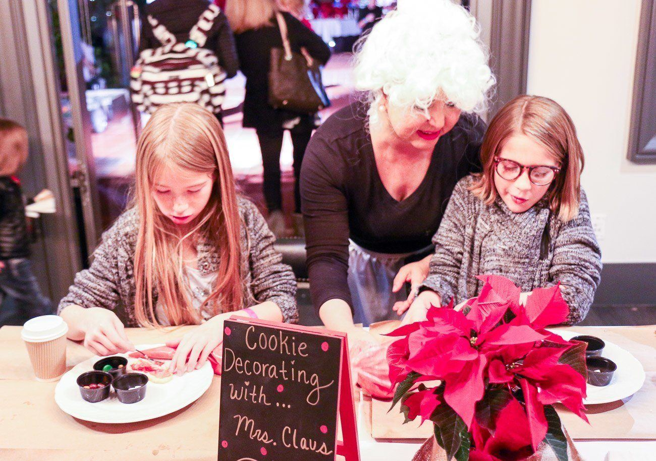 "Kids (and adults) decorated cookies with Mrs. Santa Claus at ""Let It Snow"" hosted by Four Seasons Hotel Westlake Village"