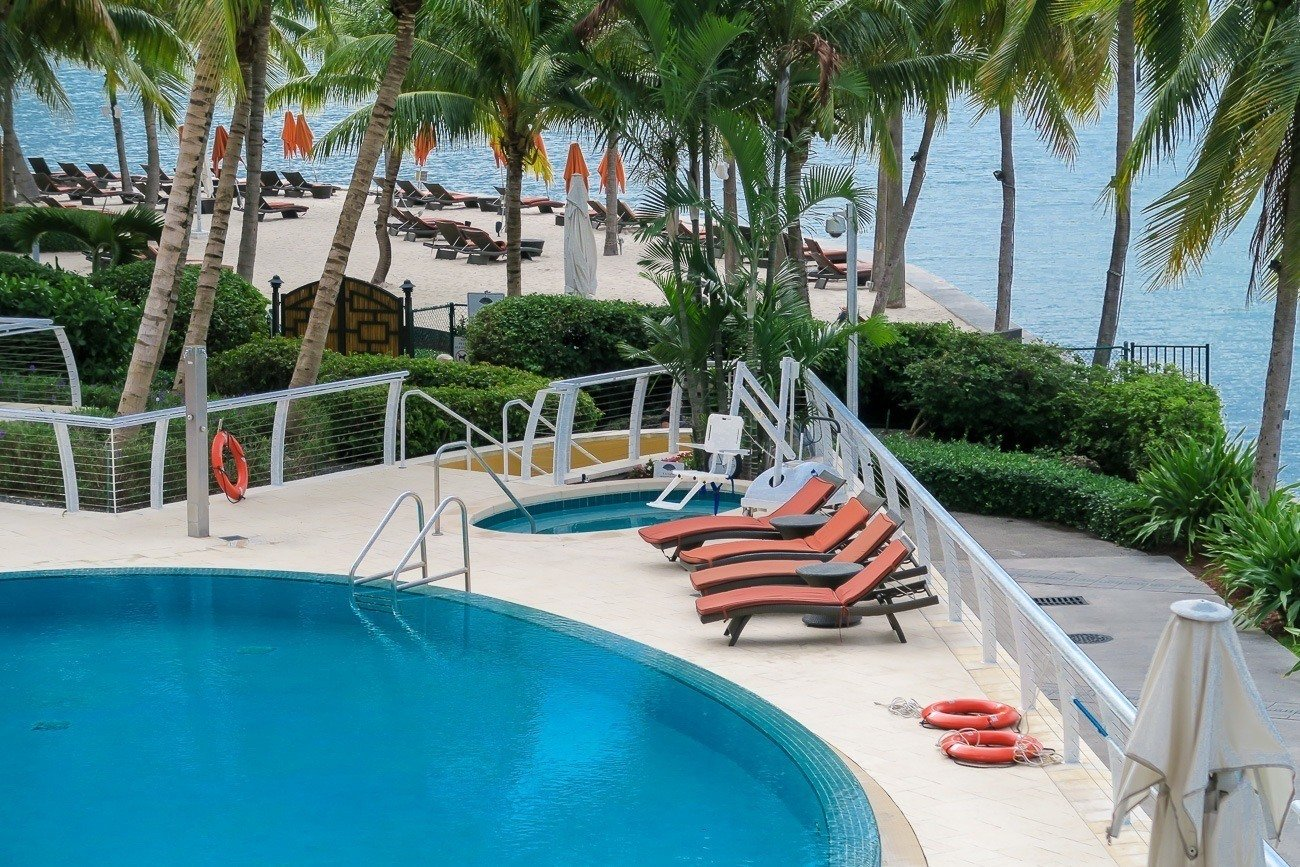 Private beach and swimming pool at Mandarin Oriental, Miami which is steps from Biscayne Bay.