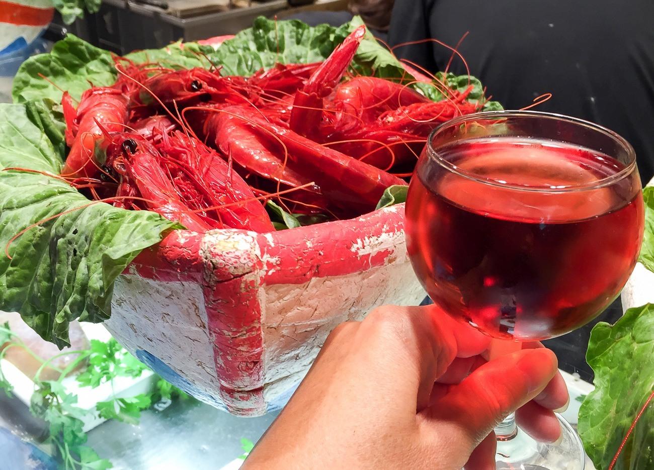 Fresh seafood and rose at BarCentral in Barcelona's La Boqueria food market.