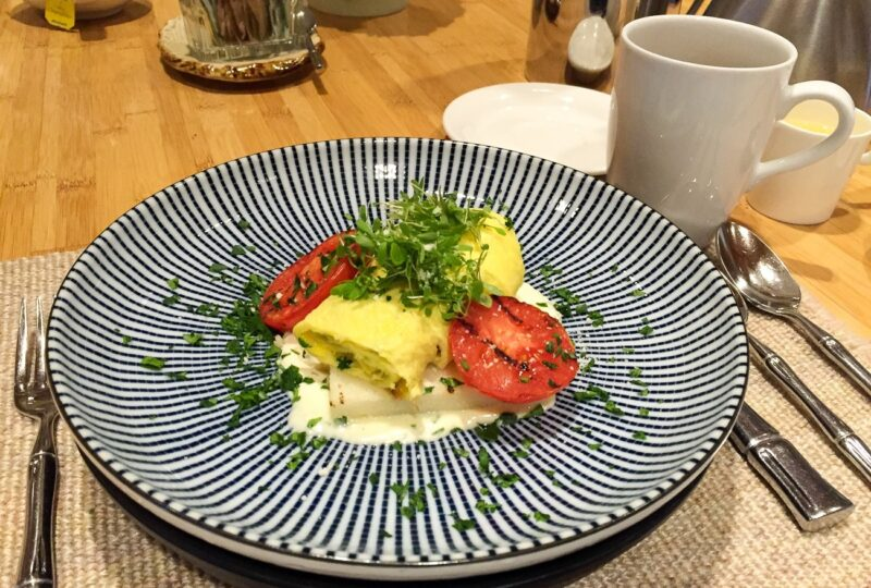 Savory herb and cheese Benedict with ricotta and farina cake at the famous Golden Door Spa.