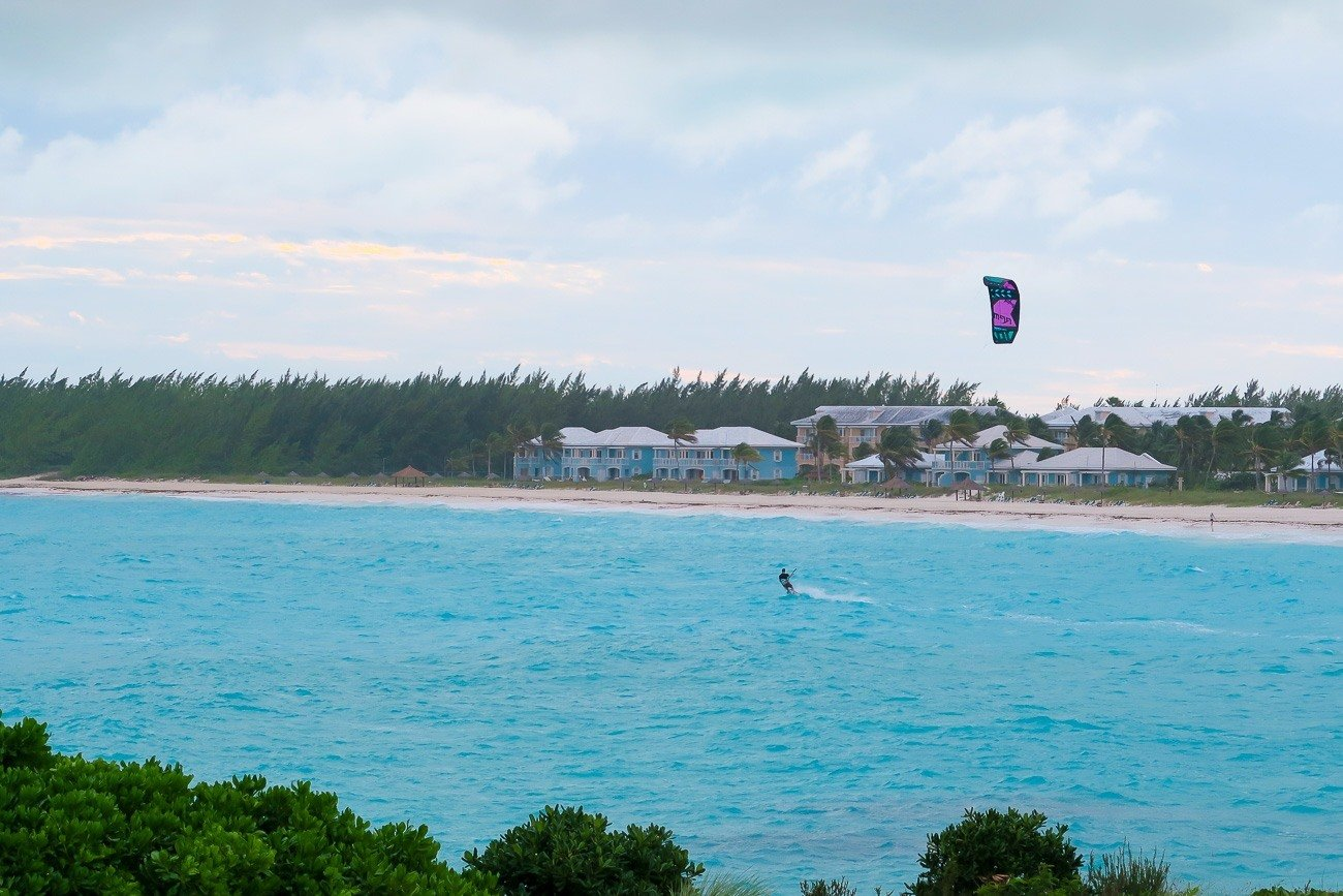 A kite surfer in front of Grand Isle Resort on Great Exuma in the Bahamas.