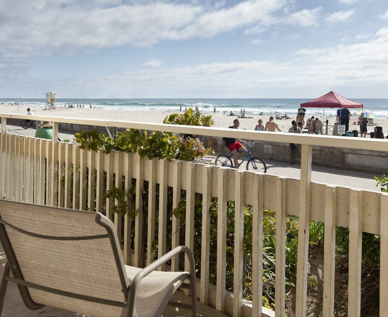 View of the boardwalk and beach from a room patio at Blue Sea Beach Hotel, one of the best beach hotels in San Diego.