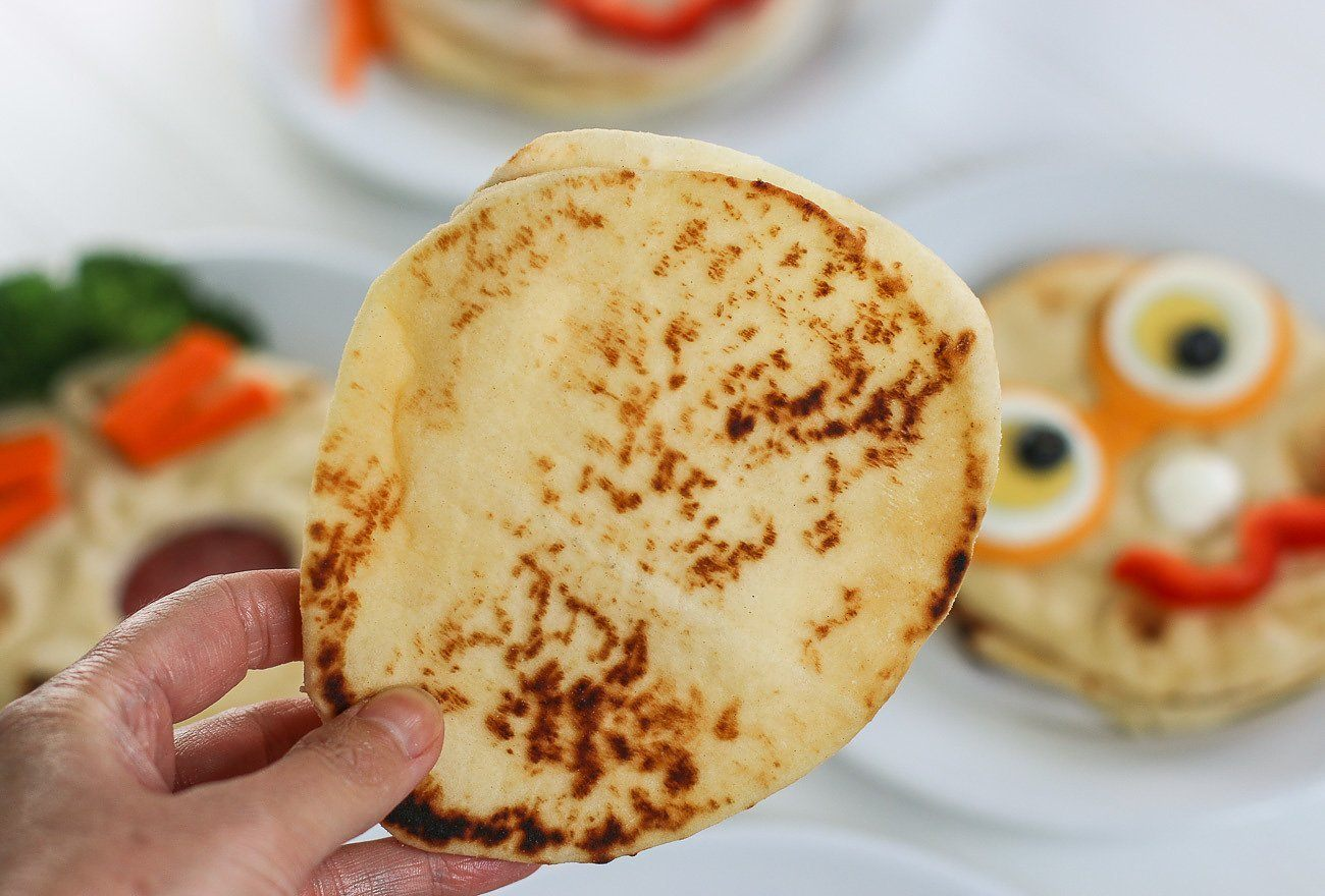 The flat side of a naan bread.