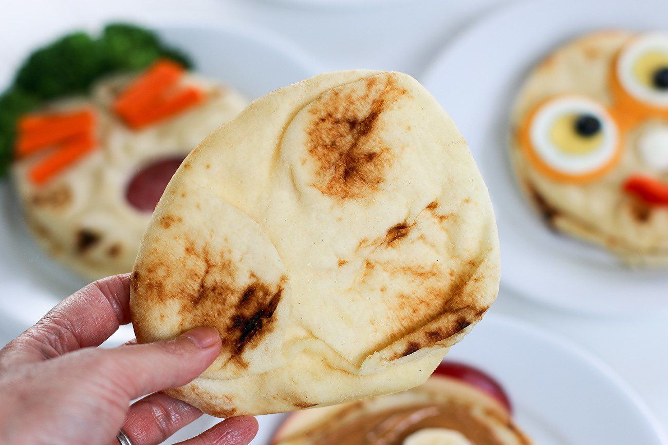 The bubbled side of naan bread.