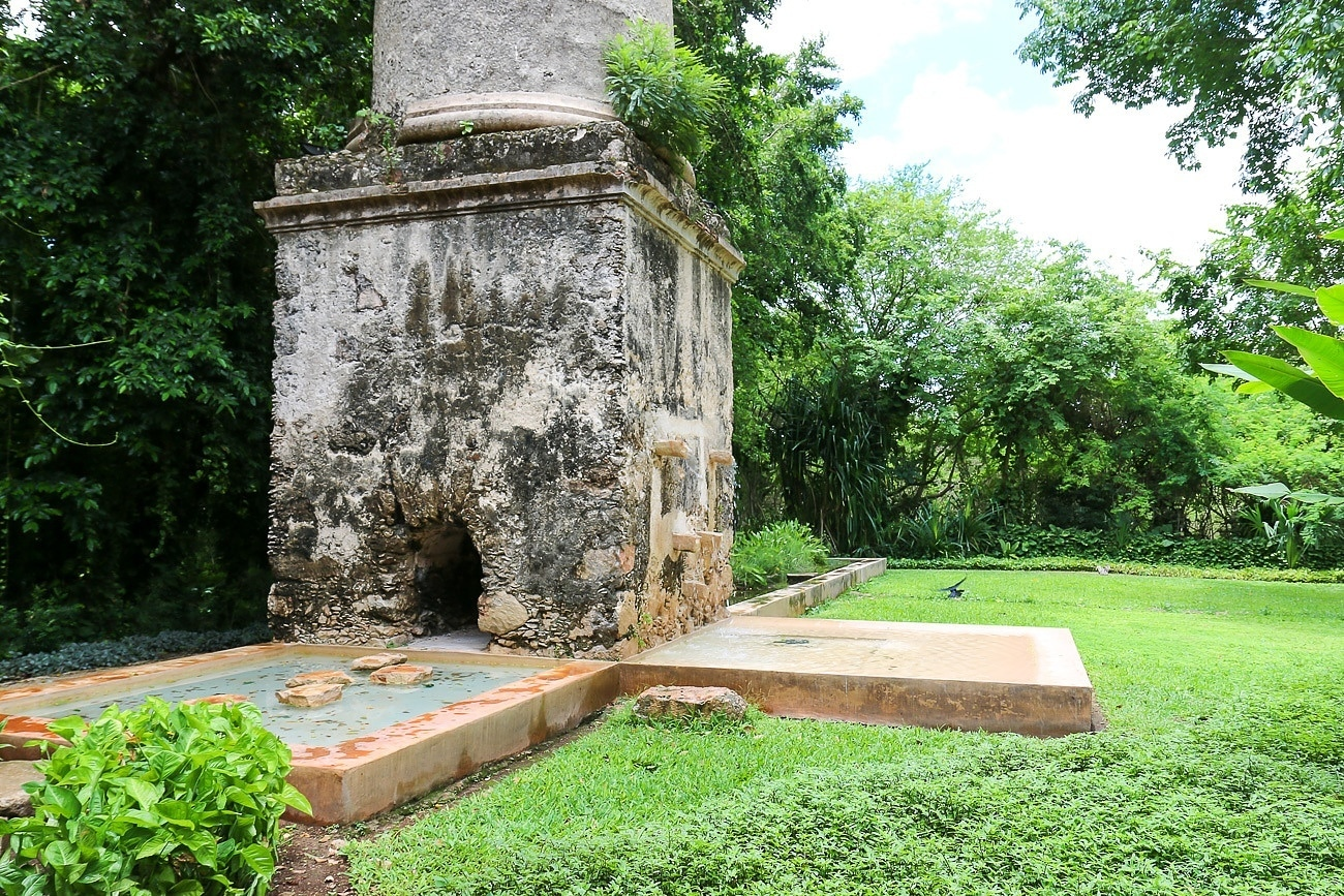 The once-operational factory chimney at Hacienda Petac is now a water feature.