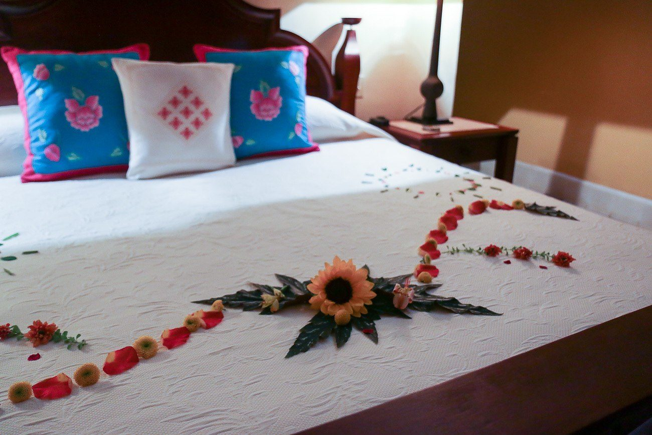 Flowers on a bed ready for guest arrival to Hacienda Petac in Merida, Mexico