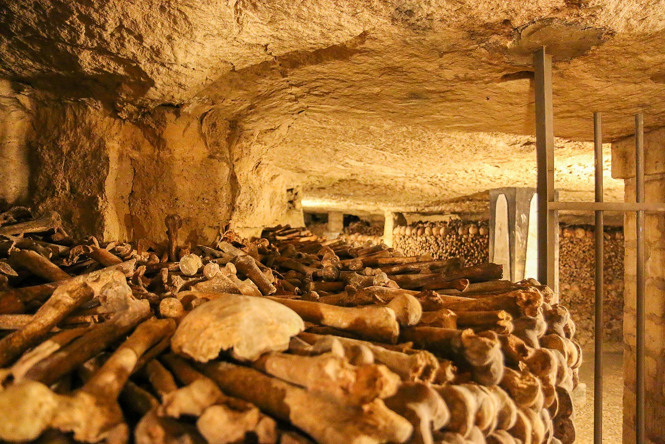The bones of about 6 million people are stacked inside the Paris Catacombs.