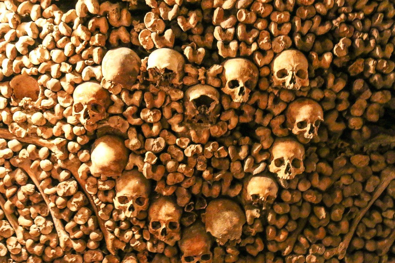 Bones are arranged in patterns inside the Paris Catacombs.