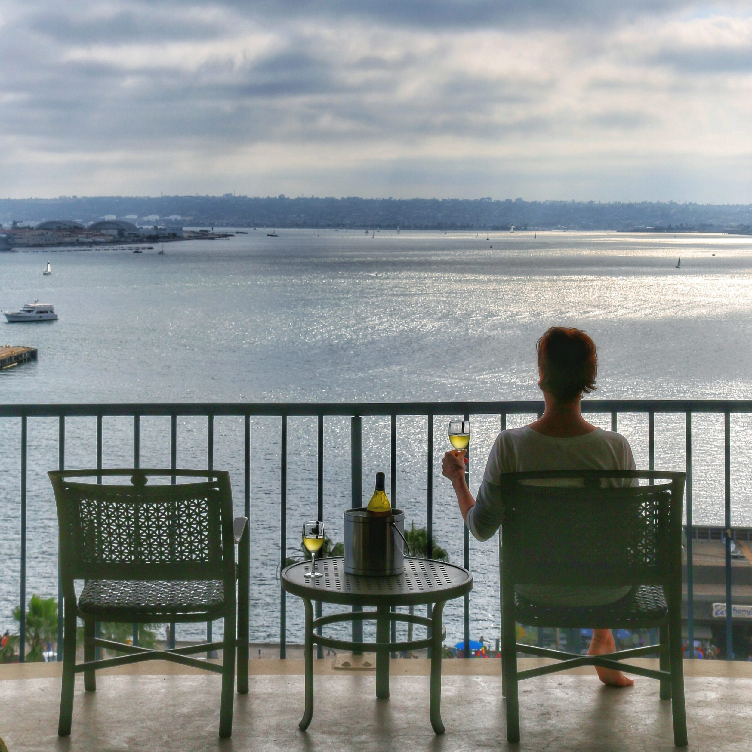 Sunset on the balcony overlooking the water at Wyndham San Diego Bayside