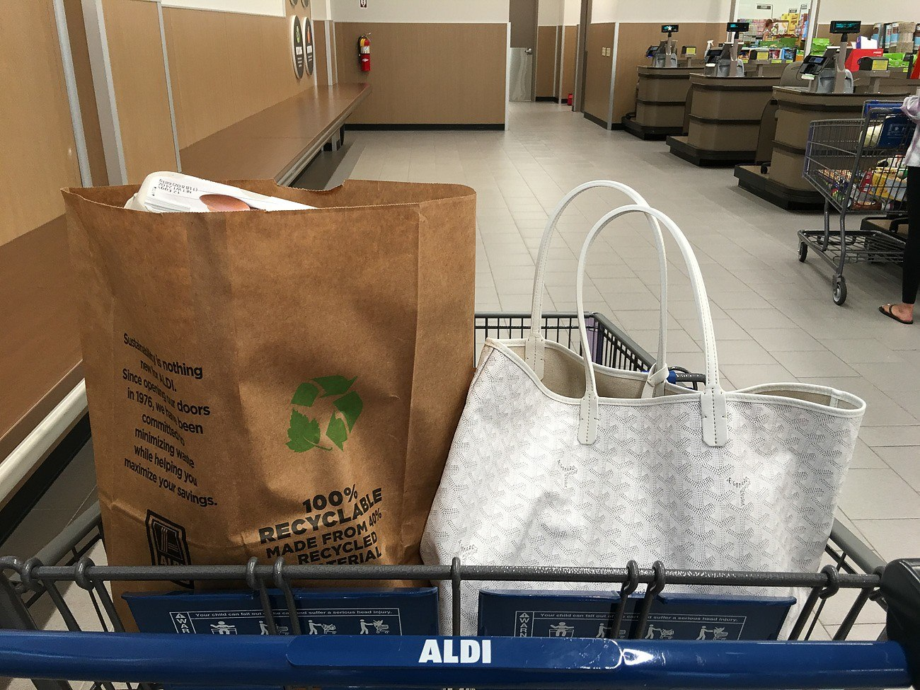 Customers bag their own groceries at Aldi San Diego