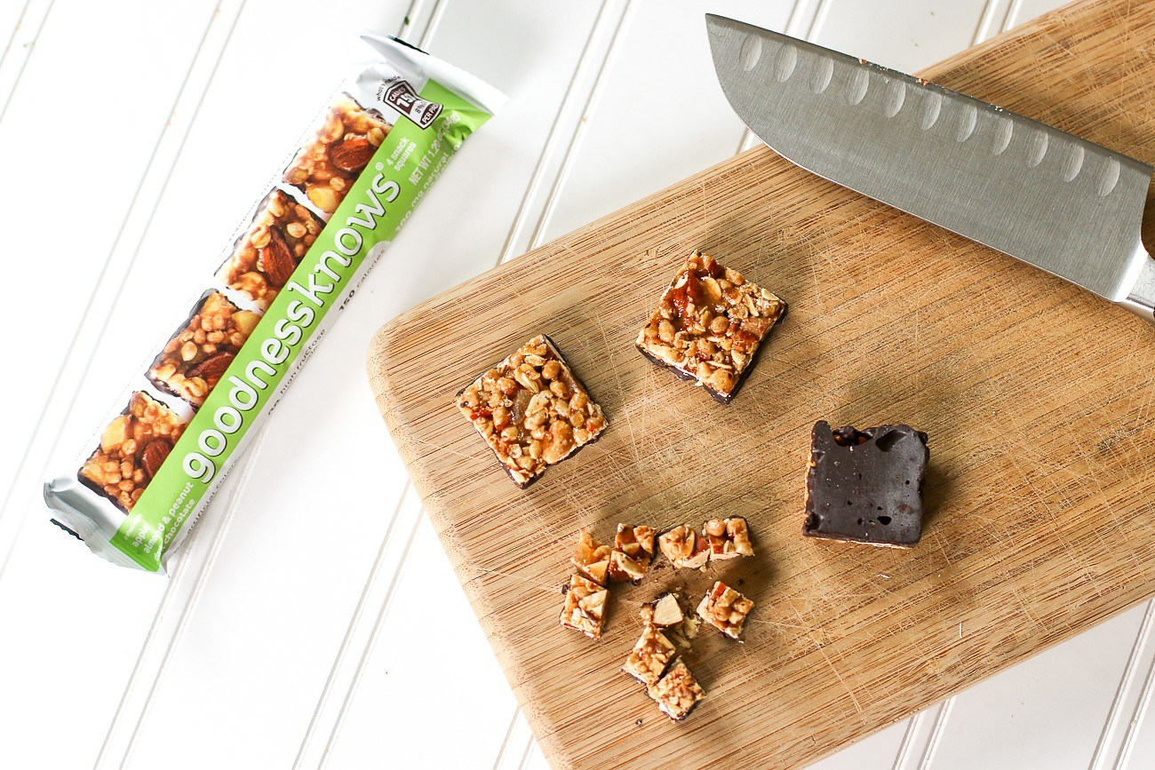 goodnessknows snack bars about to be added to a yogurt parfait.