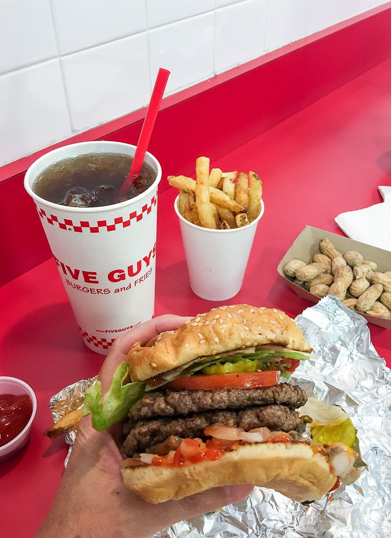 A regular burger (it's huge) at Five Guys, a casual restaurant in San Diego's Pacific Beach neighborhood