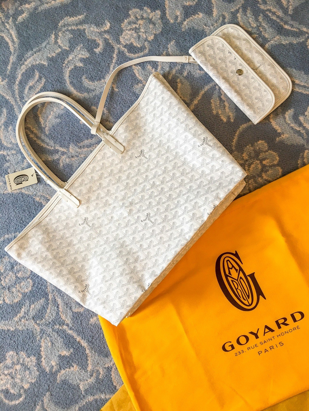 A white Goyard Saint Louis GM handbag purchased in Paris.