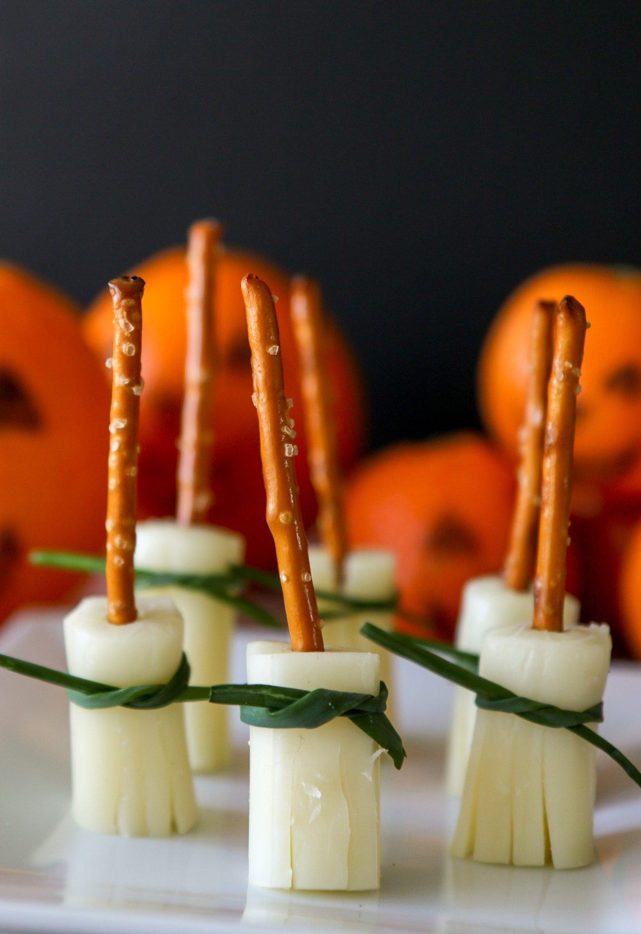 Witch broomsticks made from string cheese and pretzel sticks.