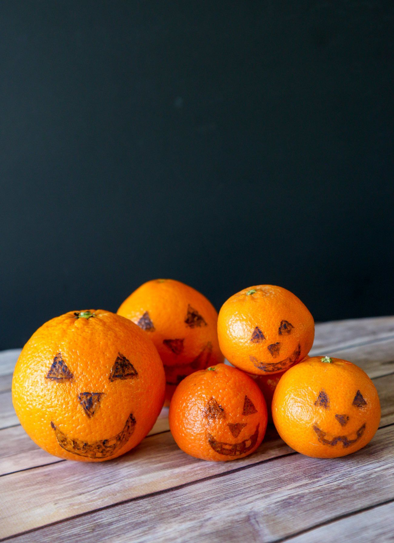 Draw jack-o-lanterns on oranges and tangerines with food safe markers for an easy Halloween snack.