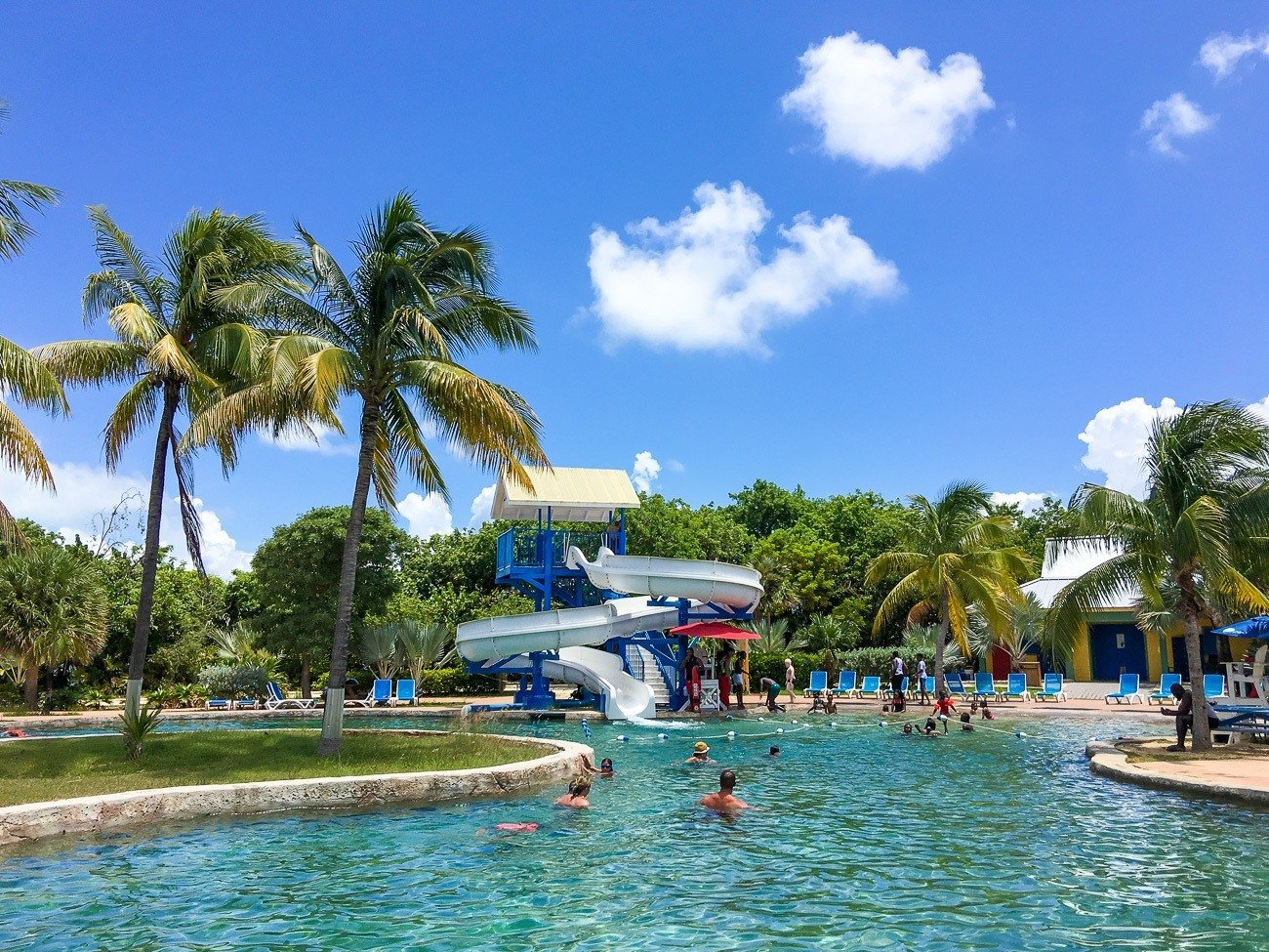 Waterslide in a pool at Cayman Turtle Centre in Grand Cayman with kids.