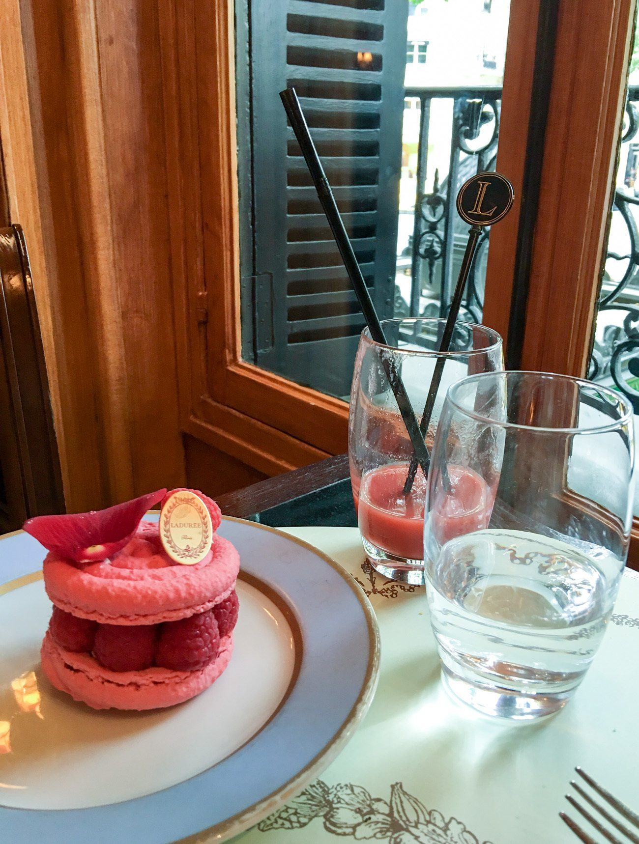 A rose and raspberry macaron dessert at the Laduree tea room on rue Royale in Paris.
