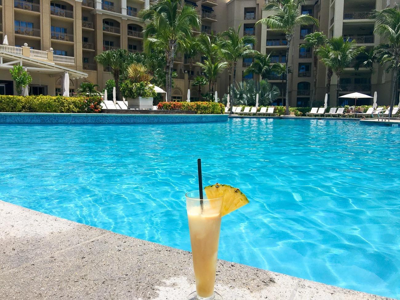 A pià±a colada at The Ritz-Carlton Grand Cayman pool