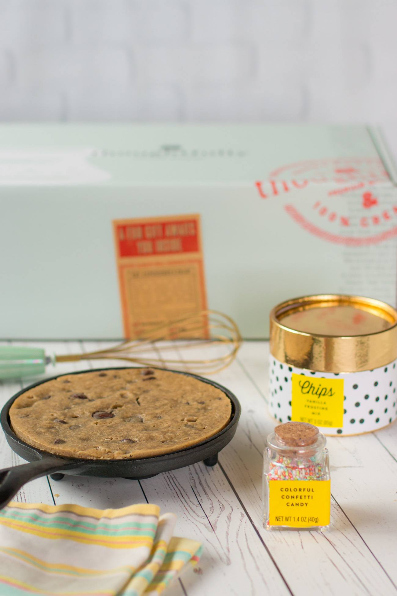 A single serve chocolate chip cookie made in a cast iron skillet that is part of a Thoughtfully gift set.