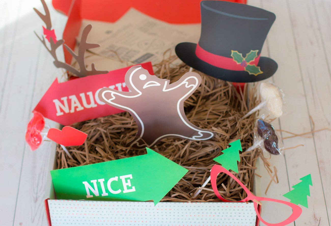 A Christmas photo booth gift box from Thoughtfully is a great hostess gift.