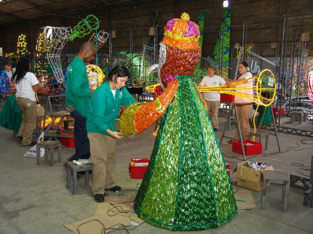 putting together some of the 31 million christmas lights of medellin