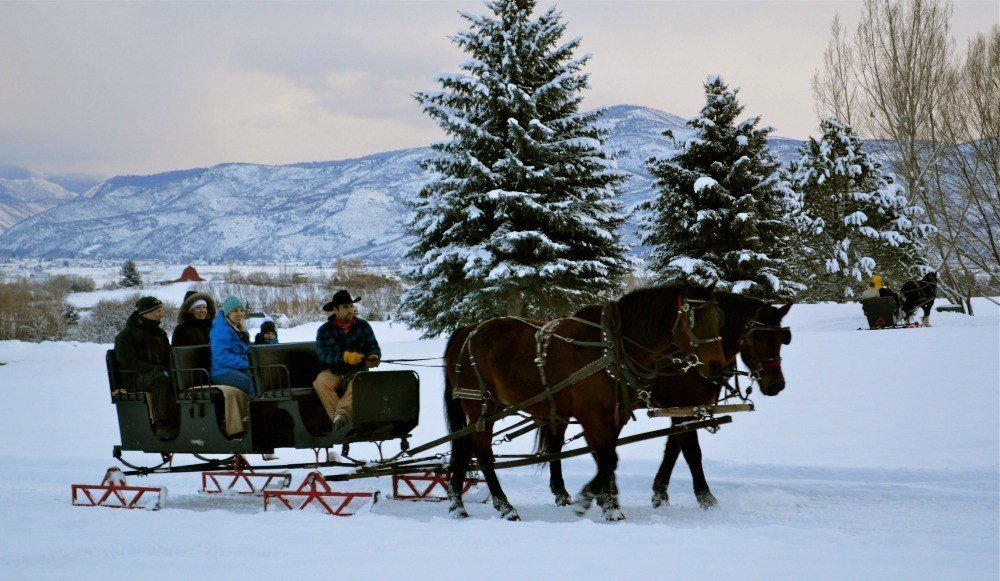 Families love taking sleigh rides in Heber Valley, Utah.