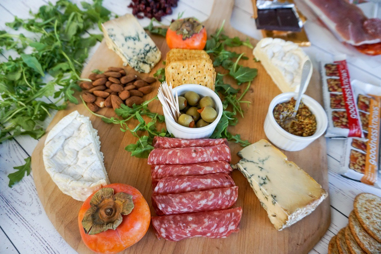 Start assembling your charcuterie and cheese platter from the center and move outward. & Tips for Making the Ultimate Charcuterie and Cheese Board - La Jolla Mom