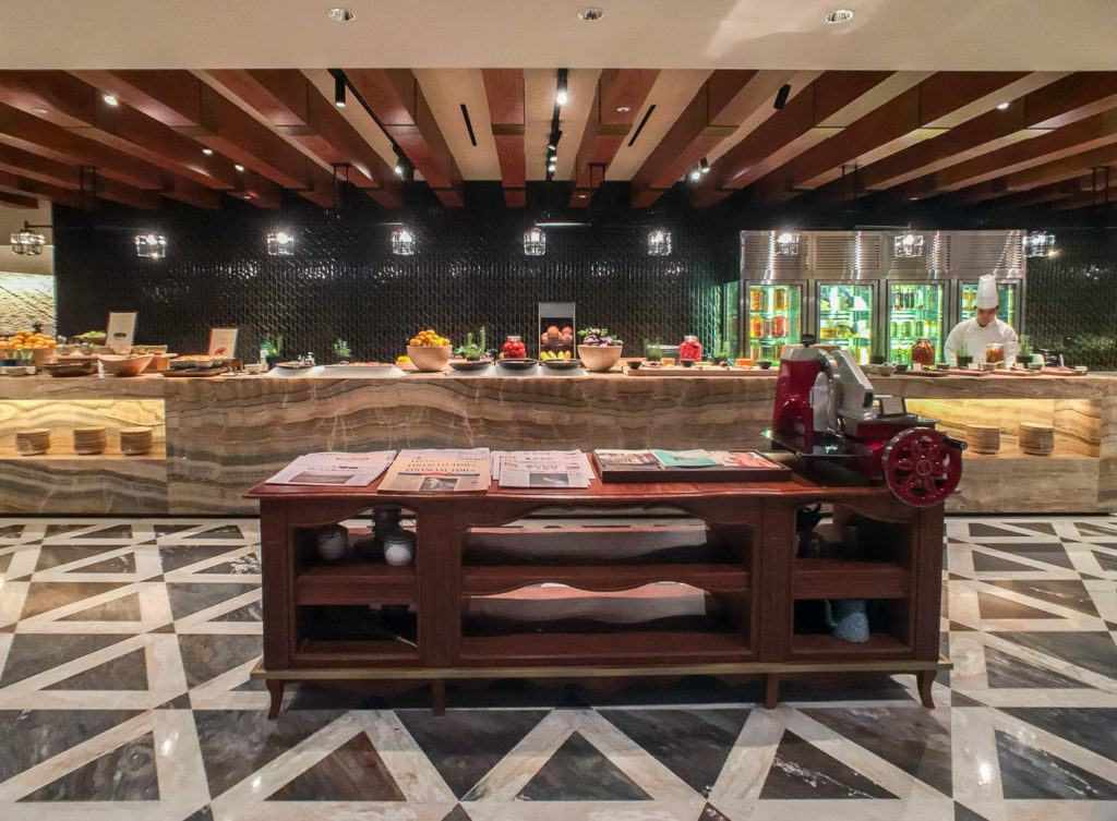 Chefs prepare food in open kitchens at Four Seasons Hotel Seoul's buffet restaurant, The Marketplace.