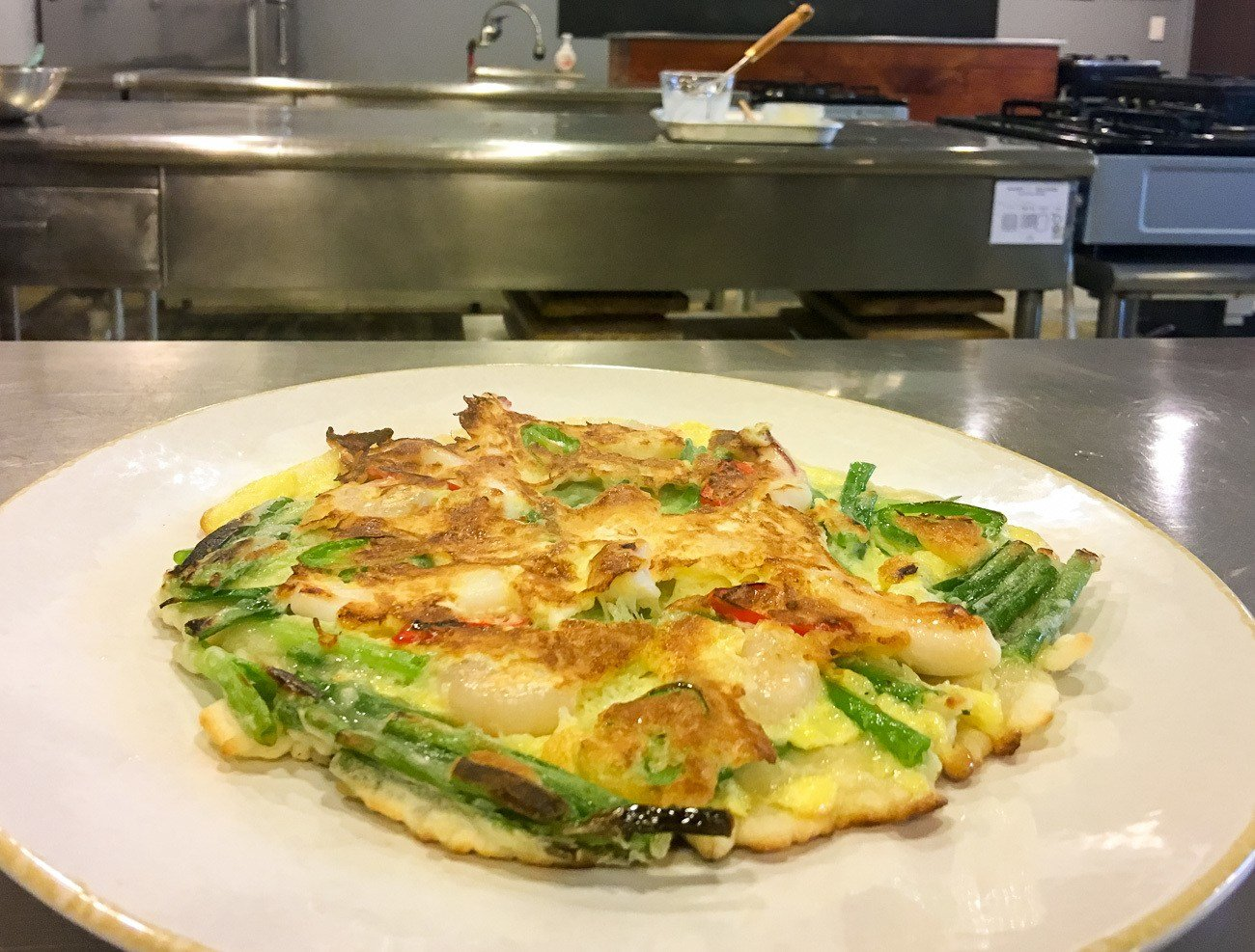 Pajeon is a delicious egg batter and scallion pancake that is a popular Korean food.