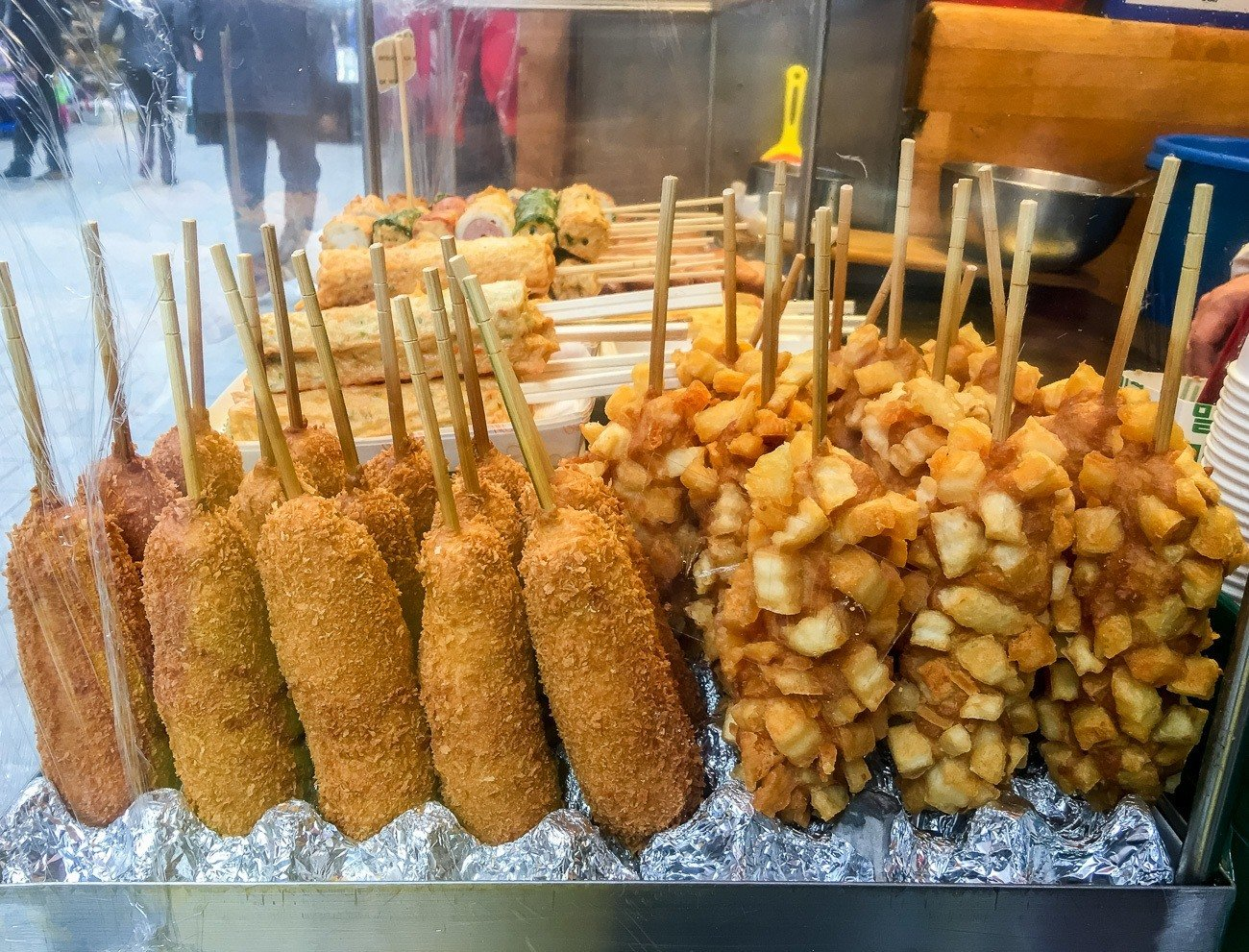 French fry covered corn dogs are a popular street food in Seoul.