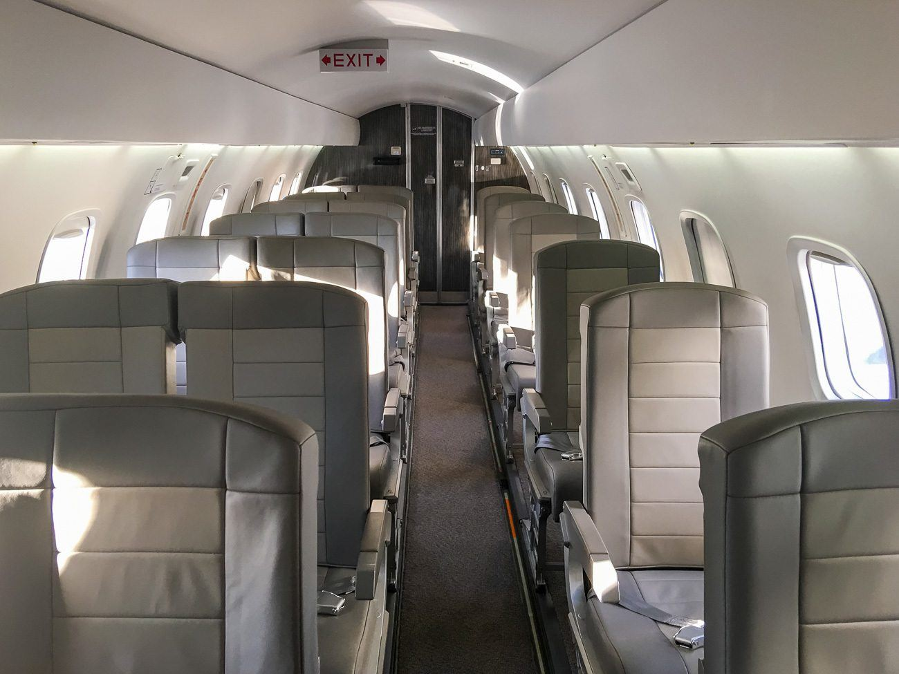 The seats of a JetSuiteX Embraer 135 have more legroom than similar planes on commercial airlines.