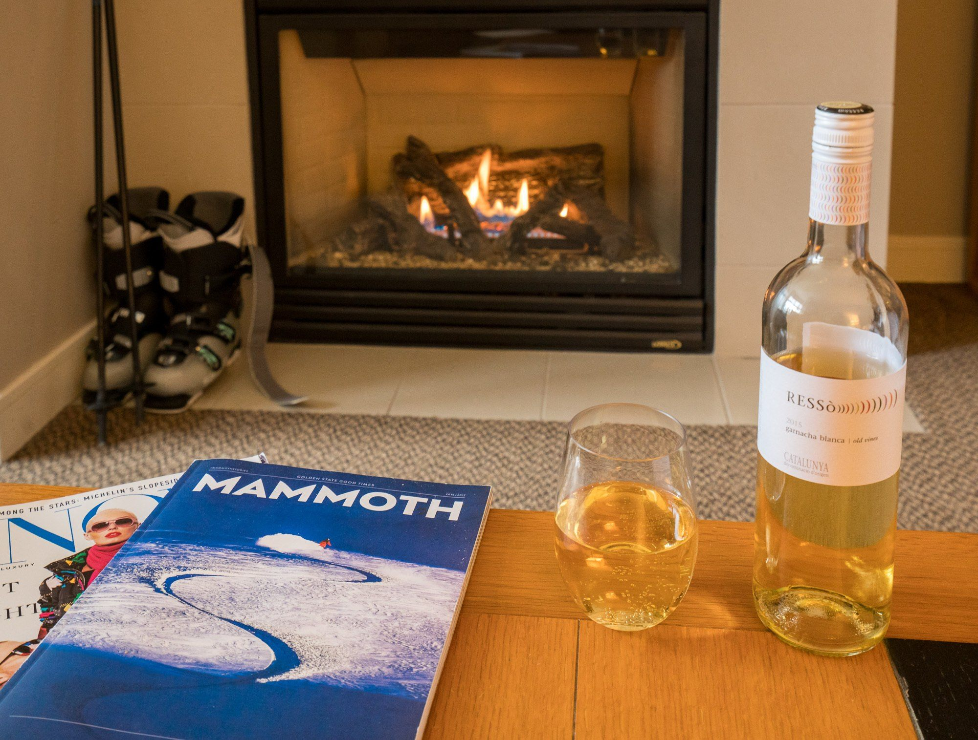 Resting by the fire after a long day of skiing at The Westin Monache Resort, Mammoth with wine from a Bleu Market and Wine Bar basket.