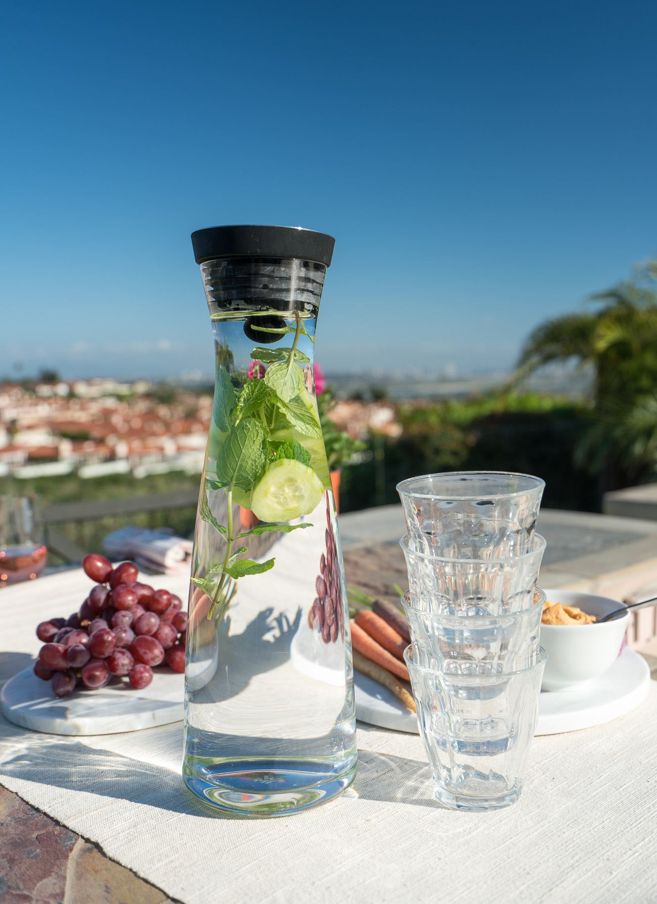 Serve flavored water in a pitcher or carafe instead of bottled water when you entertain.
