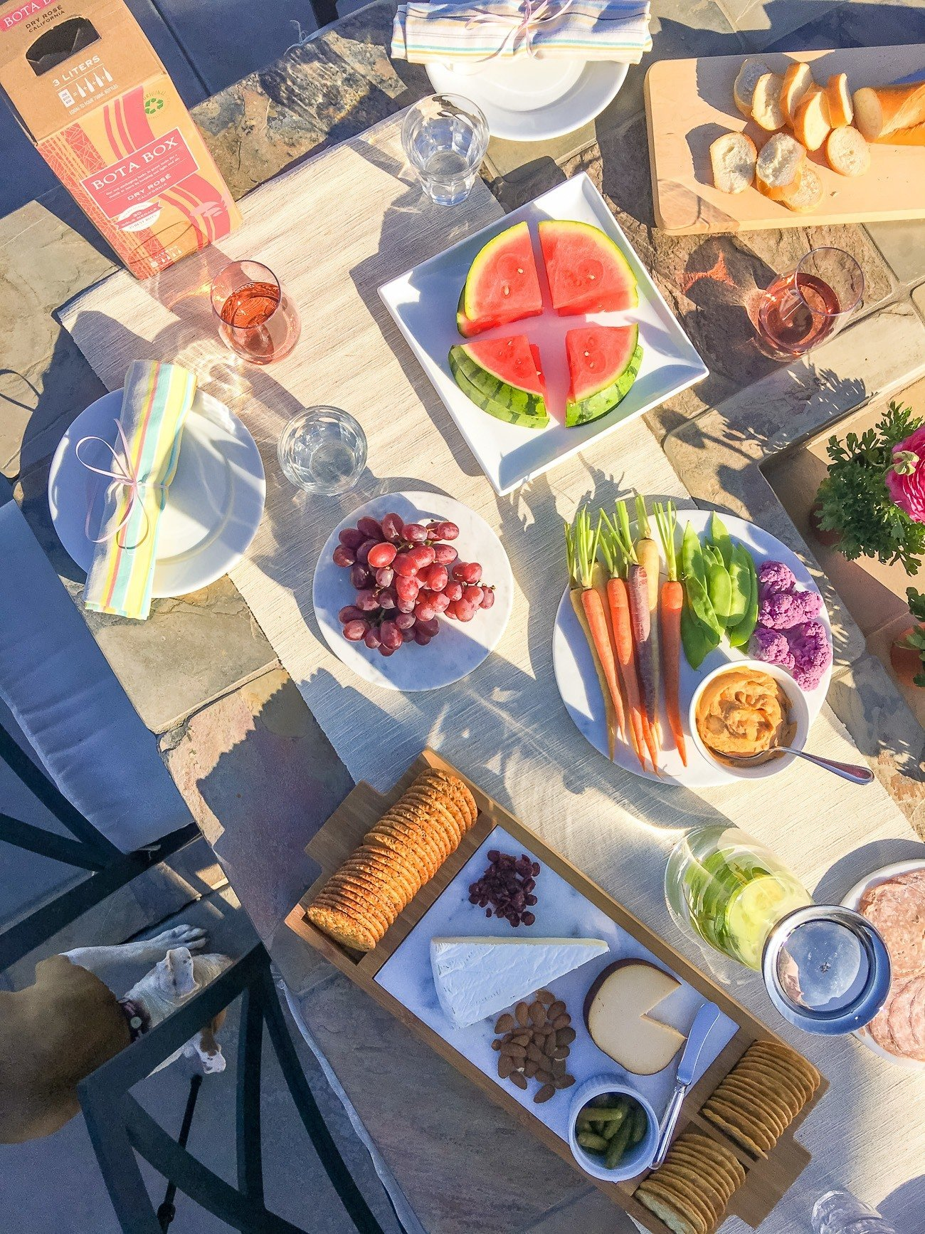 Throw an easy outdoor happy hour that's eco-friendly with these tips (including the wine).