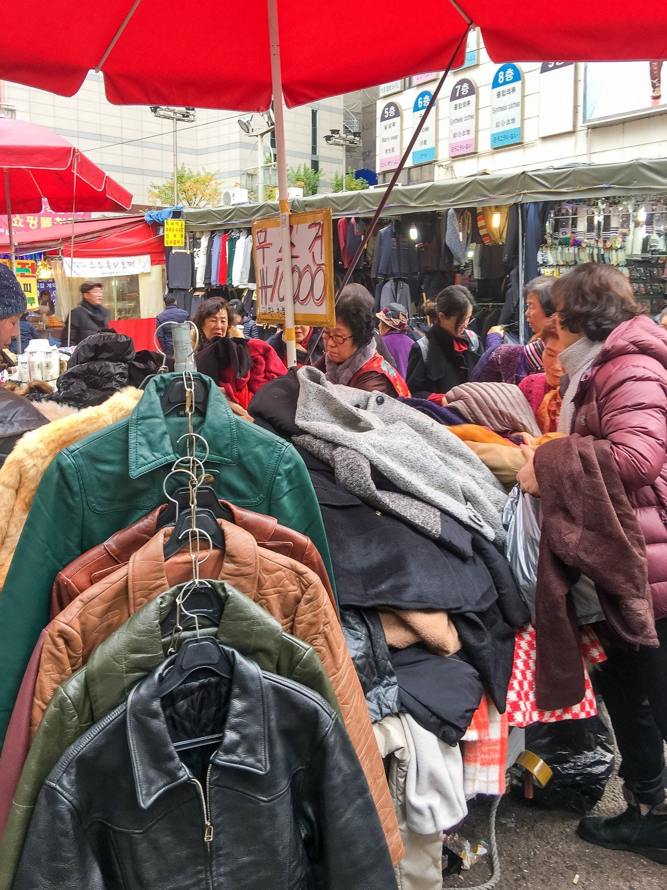 Shopping for clothing at Namdaemun Market in Seoul's Myeongdong shopping district.