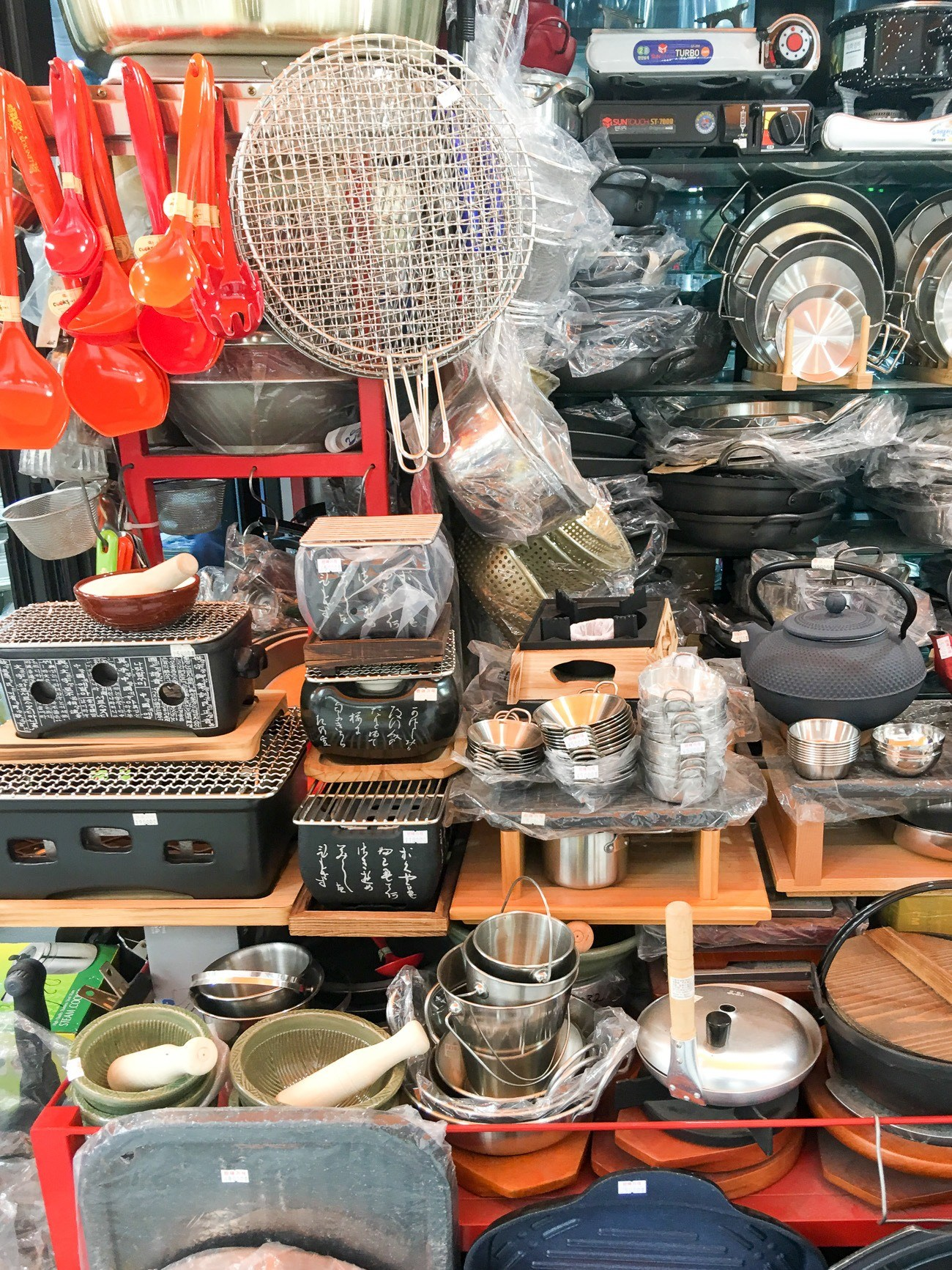 Buy housewares at Namdaemun Market in Seoul.