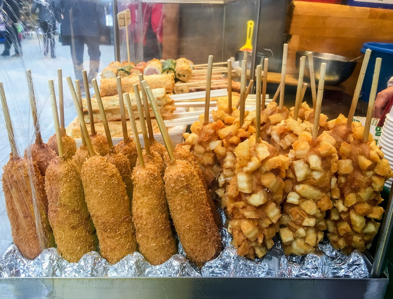 Namdaemun Market in Seoul also have amazing street food, like corn dogs covered in french fries.