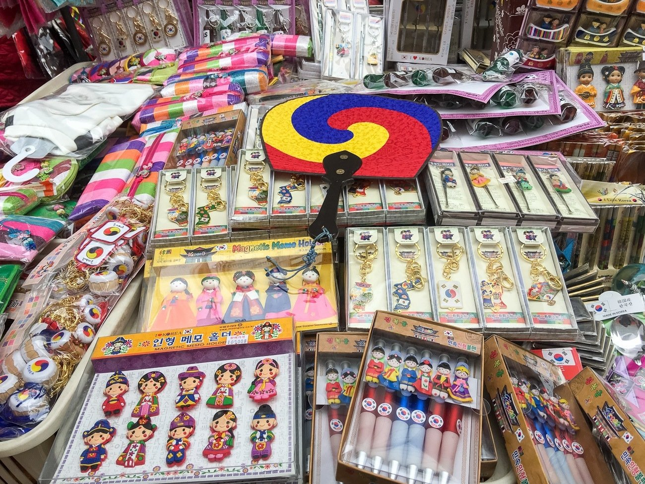 Buy souvenirs at Namdaemun Market in Myeongdong, Seoul's famous shopping district.