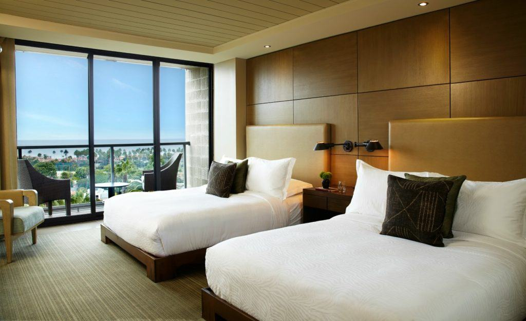 Hotel La Jolla, a Curio Collection double room interior with balcony and ocean view