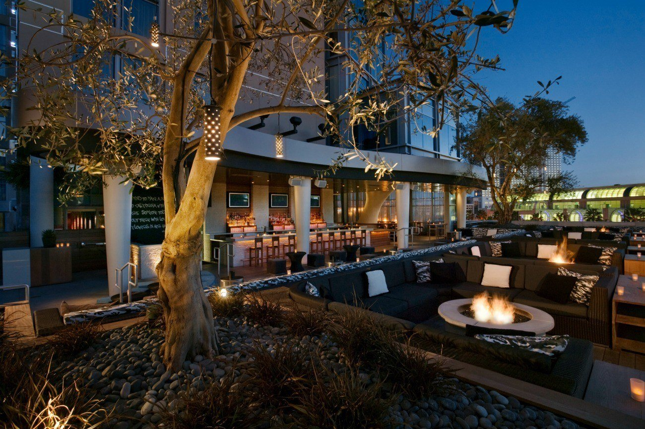Hard Rock San Diego outdoor lounge and bar seating areas after sunset.