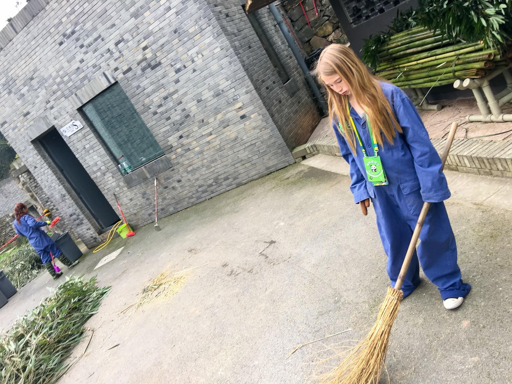 Sweeping the main area at Dujiangyan Panda Base
