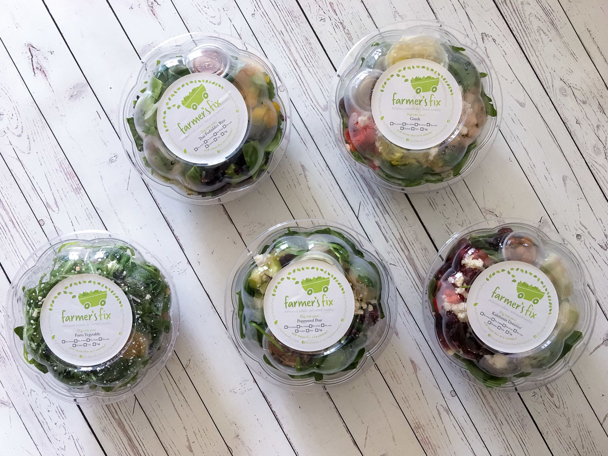 Farmer's Fix salads in their packaging. I love this San Diego salad delivery company.