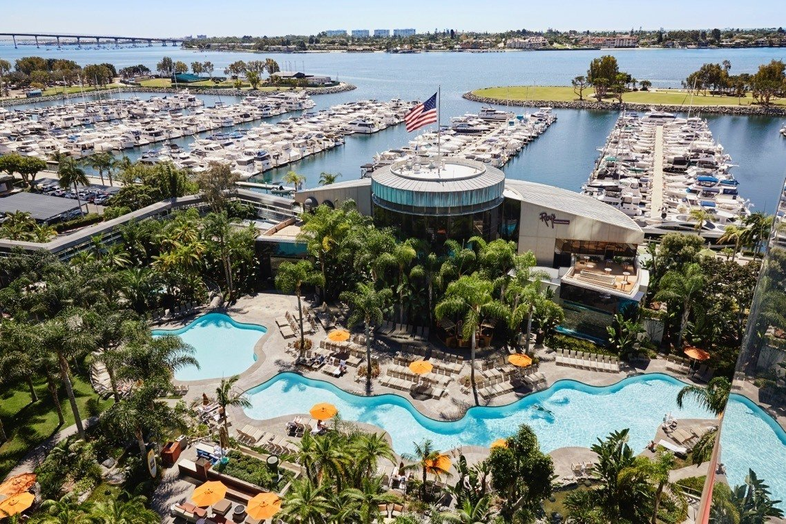 Aerial view of Marriott Marquis San Diego pool and marina full of boats.