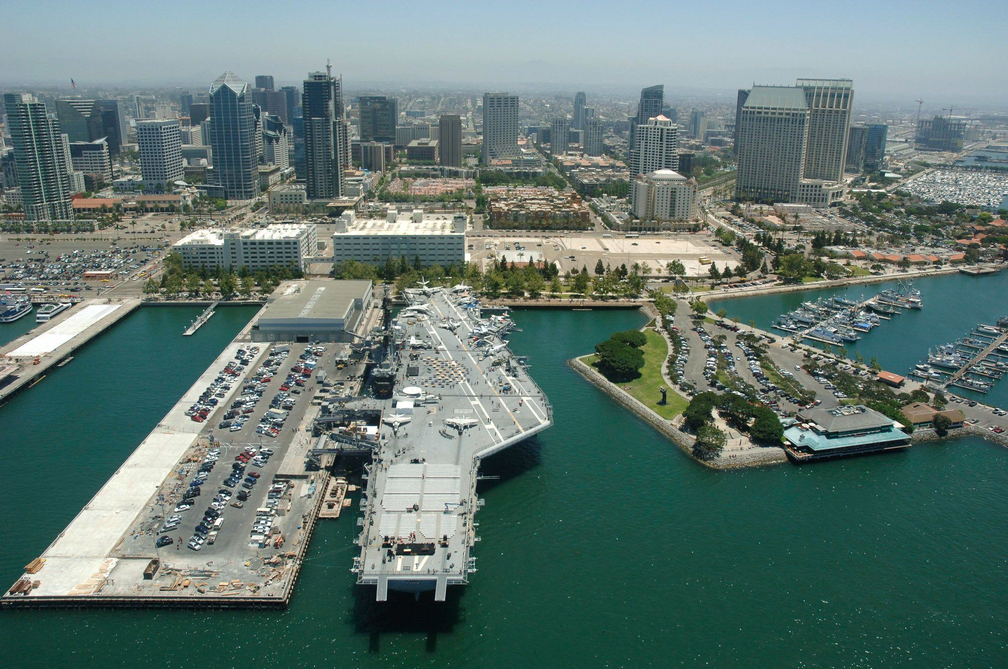 An aerial view of the USS Midway and the downtown San Diego skyline.