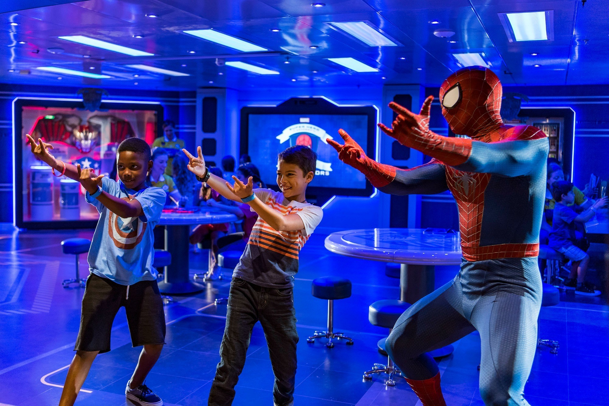 On the Disney Wonder, young guests get a special visit from Spider-Man while training at the Marvel Super Hero Academy in Disney's Oceaneer Club