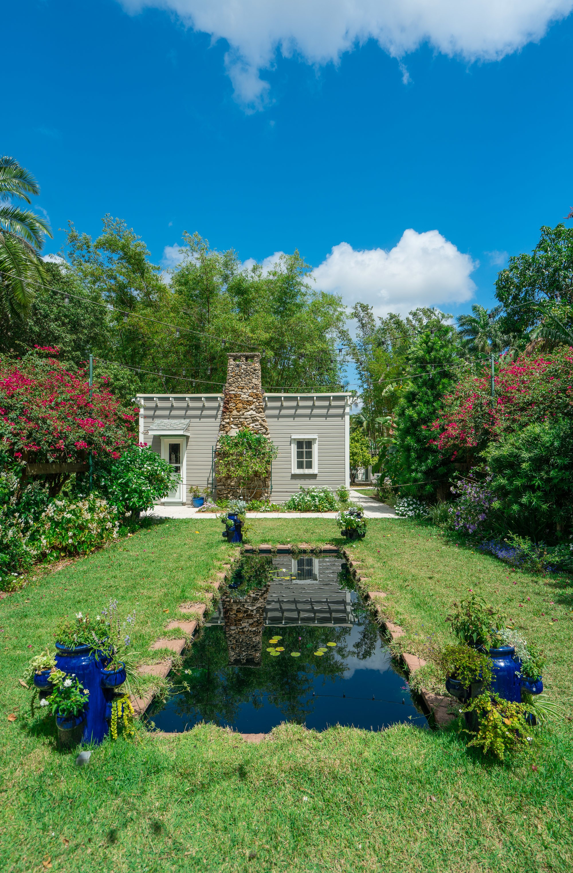 The Moonlight Garden at the Edison & Ford Winter Estates where the moon's reflection can be seen in this pool.