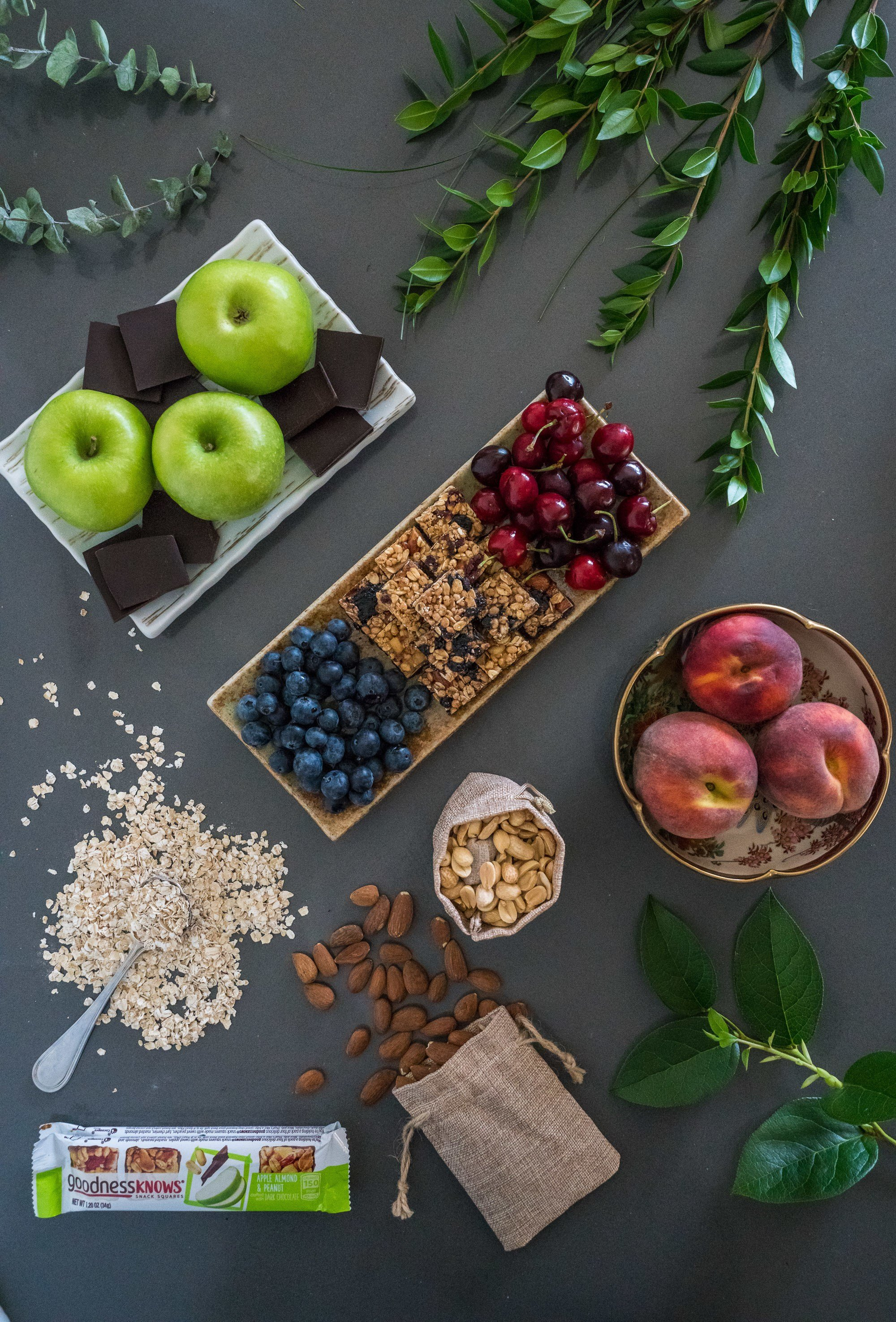 Fruit, nuts, chocolate and oats are the ingredients in a goodnessknows snack square.