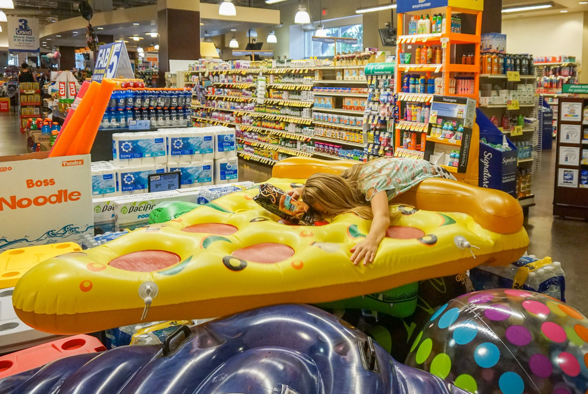 A pizza pool float at Albertsons San Diego.