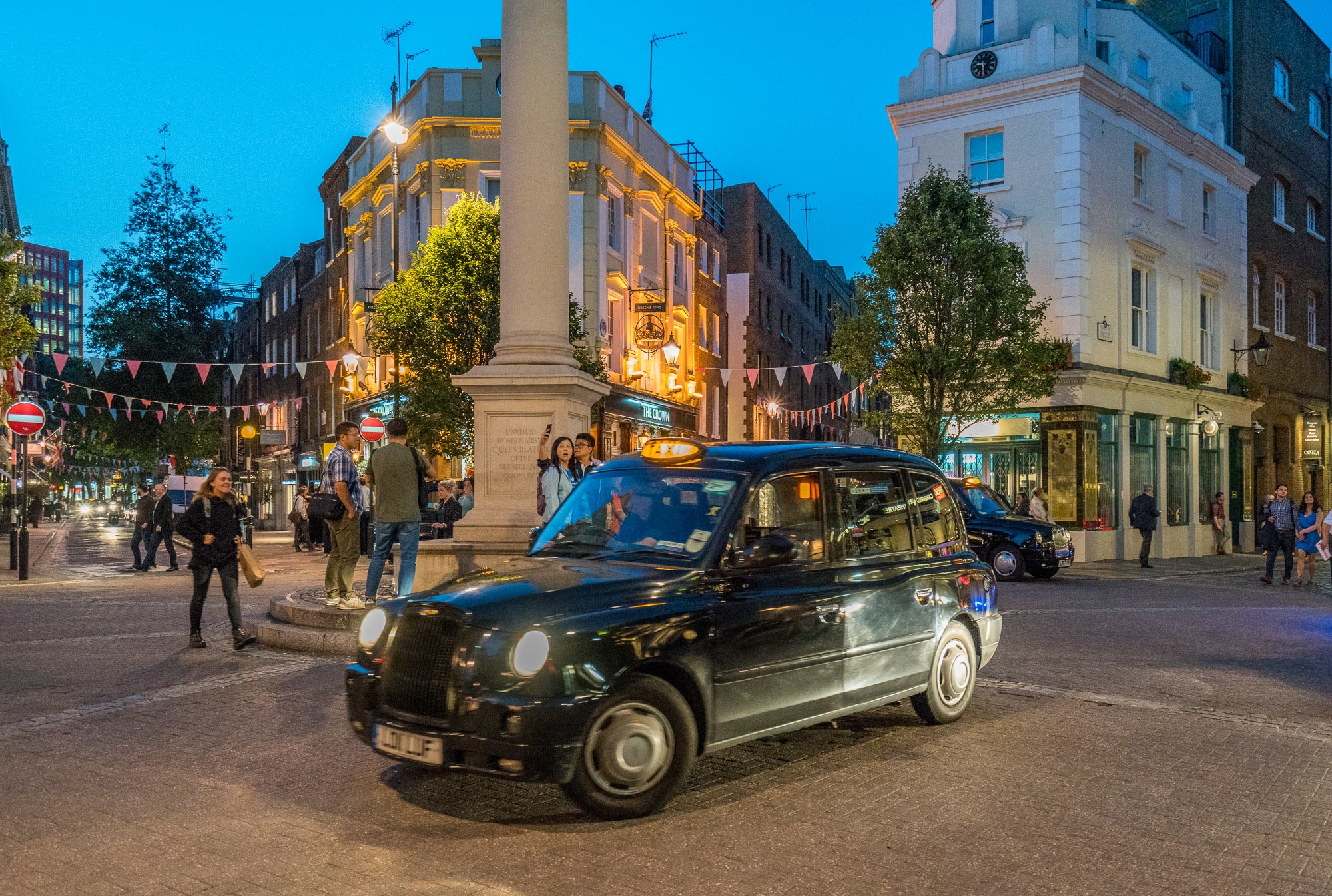 A London taxi in Covent Garden at night.